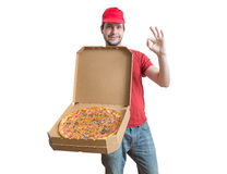 Concept de la livraison de pizza Le jeune homme porte des boîtes avec la pizza savoureuse Images libres de droits