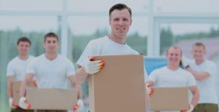 Concept de la professionnalisme : l'équipe d'affaires dans les gants examine Photographie stock
