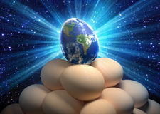Concept de la terre de planète d'oeufs de pâques Photos stock