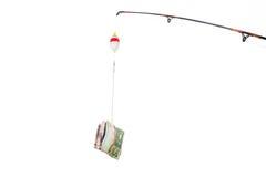 Concept de ligne de pêche avec la devise d'argent comme amorce ou incitation Images libres de droits