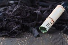 Concept de lingerie et d'argent : Amour pour l'argent Photographie stock