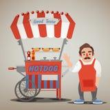 Concept de nourriture de rue avec le chariot et le vendeur de hot-dog Photo stock