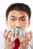 Concept de paiement illicite, bouche scellée avec le billet d'un dollar Image stock