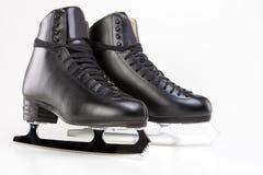 Concept de patinage artistique : Le chiffre patins des hommes professionnels d'isolement Photographie stock