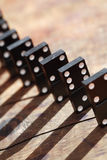 Concept de principe de domino Photographie stock libre de droits