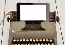 Concept de progrès de technologie - vieille machine à écrire et nouveau comprimé p photos stock
