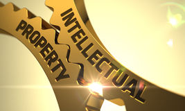 Concept de propriété intellectuelle Roues dentées d'or 3d Images stock