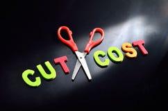 Concept de réduction des coûts Photo libre de droits