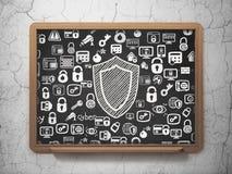 Concept de sécurité : Bouclier sur le fond de conseil pédagogique Photographie stock libre de droits