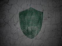 Concept de sécurité : Bouclier sur le fond grunge de mur Photo stock