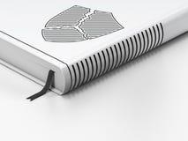 Concept de sécurité : livre fermé, bouclier cassé sur le fond blanc Image libre de droits