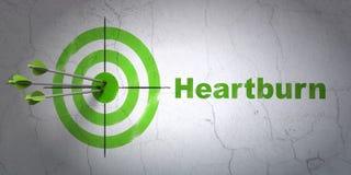 Concept de santé : cible et Heartburn sur le fond de mur Photographie stock libre de droits