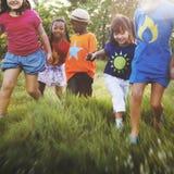 Concept de sourire de bonheur d'unité d'amitié d'enfants Photos stock