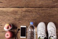 Concept de sport et de forme physique sur en bois Photographie stock libre de droits