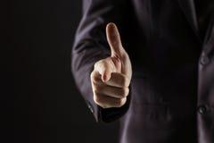Concept de succès dans les affaires : homme d'affaires dirigeant son doigt en avant Images libres de droits