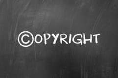 Concept de symbole de Copyright sur le tableau noir Image libre de droits