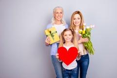Concept de tendresse de confiance de soin de beauté de positivité Trois commutateurs de famille Photos stock