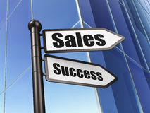 Concept de vente : succès de ventes de signe sur le fond de bâtiment Image libre de droits