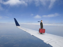Concept de voyage d'affaires, homme d'affaires Flying sur le jet Photos stock