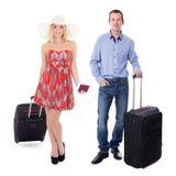 Concept de voyage - jeune ajouter aux valises d'isolement sur le blanc Image libre de droits