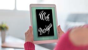 Concept de web design sur un comprim? images stock