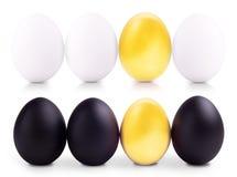 Concept de witte, gouden en zwarte eieren van Pasen Stock Foto