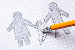 Concept of the death of child, Loss. The family is painted on paper with pencil and the child is erased.  stock photos