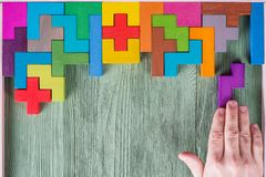 Concept of decision making process, logical thinking. Logical tasks. Conundrum, find the missing piece of the proposed. Hand holding puzzle element. Background Stock Image