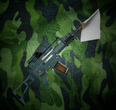 Concept defeat white flag from the barrel of the machine 3d illu. Stration on camouflage background image Stock Photos