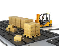 Concept of delivering, shipping or logistics. Forklift on keyboard Royalty Free Stock Images