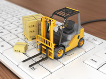 Concept of delivering, shipping or logistics. Forklift on keyboard Stock Photos