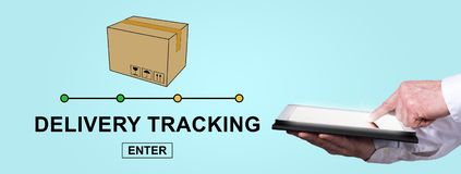 Concept of delivery tracking. Finger pointing on digital tablet with delivery tracking concept on background royalty free stock photos