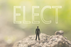Concept of democracy. With a person stand in the outdoor and looking up the text over the sky in nature background royalty free stock images