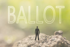 Concept of democracy. With a person stand in the outdoor and looking up the text over the sky in nature background stock photo