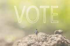 Concept of democracy. With a person stand in the outdoor and looking up the text over the sky in nature background stock image