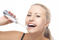 Concept of Dental Health: Blond Caucasian Woman Brushing Her Tee Stock Photography
