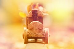 Concept design autumnal mood, yellow foliage on a background and a toy train. Fall October or November. Brightly colored maple leaves during autumn stock photo