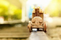 Concept design autumnal mood, yellow foliage on a background and a toy train. Fall October or November. Brightly colored maple leaves during autumn royalty free stock photography