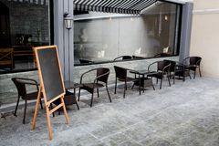 Concept and design front of Coffee Shop. With black board and black seating stock photo