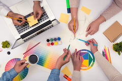 Concept of designer teamwork brainstorming planning meeting.  Royalty Free Stock Photo