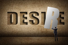 Concept of desire. Asian business man with hold a word to fill the wall royalty free stock images