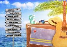 Concept die de zomer met oud koffer en de stadsteken van Aruba reizen royalty-vrije stock fotografie