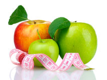 Concept of diet, apples with measuring tape Royalty Free Stock Images