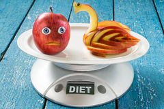 Concept of diet and weight loss: Apple - Swan Royalty Free Stock Photography