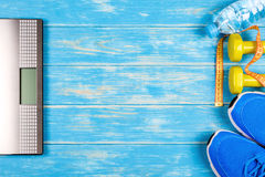 Concept of dieting and fitness plan on blue wood background. Royalty Free Stock Images