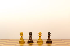 Concept of different ethnicity. With pawns of chess Stock Image