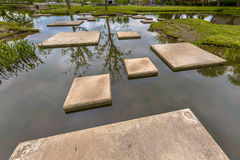 Maze of Stepping stones in pond Royalty Free Stock Image