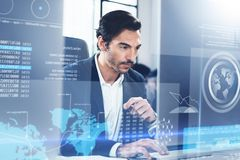 Concept of digital diagram,graph interfaces,virtual display,connections screen, online icon.Young man programmer working Royalty Free Stock Photography