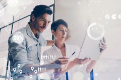 Concept of digital diagram,graph interfaces,virtual screen,connections icon on blurred background.Coworking team meeting Royalty Free Stock Photo