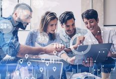 Concept of digital diagram,graph interfaces,virtual screen,connections icon on blurred background.Group of colleagues. Working with startup project in modern Royalty Free Stock Photos